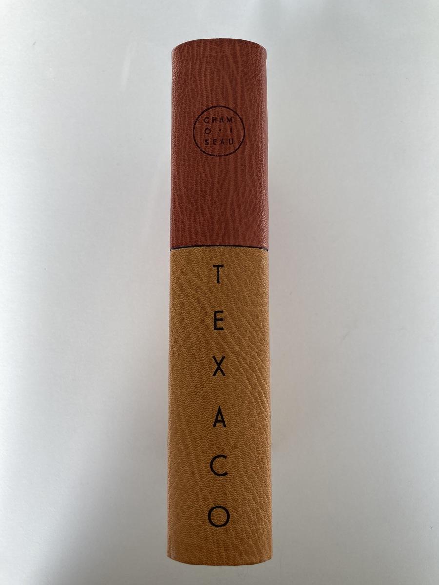 Texaco de P. Chamoiseau, reliure de création plein cuir à décor mosaïqué.