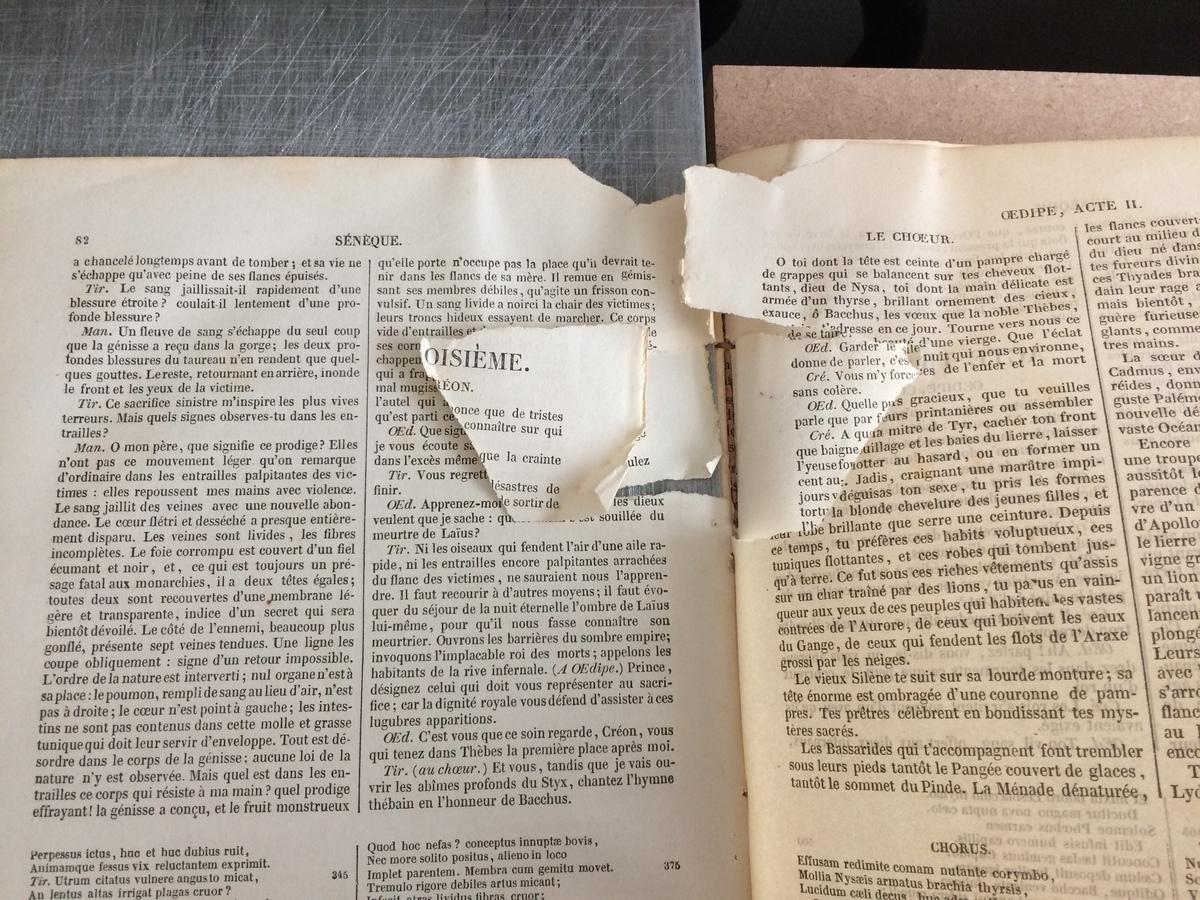 Avant : un cahier complet avec déchirures et lacunes.